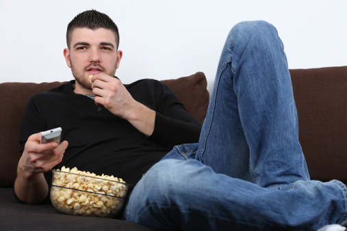 Young-Man-on-Couch-Eating-Popcorn.jpg